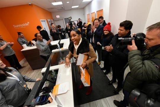 Illinois Lt. Gov. Juliana Stratton reacts after purchasing recreational marijuana at Sunnyside dispensary Wednesday.