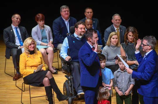 Fifth Ward councilman Justin Elpers is sworn-in at the noon swearing-in for the Evansville city government officials Wednesday at The Victory. The ceremony included Mayor Winnecke and nine members of the City Council, five of whom are new, on Jan. 1, 2020.