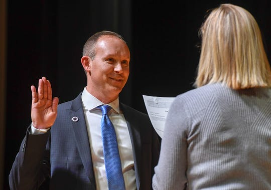 At-Large councilman Jonathan Weaver is sworn-in during the noon swearing-in for the Evansville city government officials Wednesday at The Victory. The ceremony included Mayor Winnecke and nine members of the City Council, five of whom are new, on Jan. 1, 2020.