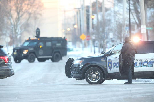 SWAT units are at at scene of a standoff New Year's Day morning near the 100 block of Hamilton Place. The 911 center received several reports of a man firing a gun in the area.