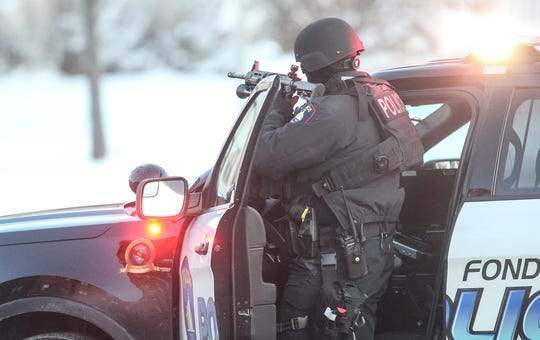 The Fond du Lac Police Department with assistance from Fond du Lac County Sheriff's Department and Wisconsin State Patrol work a scene Wednesday, Jan. 1, 2020, in the 100 block of Hamilton Place in Fond du Lac, Wis., where a person reportedly fired a gun.