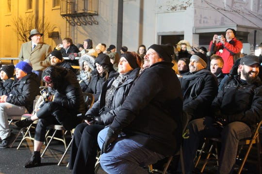 Residents watch as Fremont is honored as one of Ohio Magazine's 2019 Best Hometowns Tuesday at the city's downtown New Year's Eve celebration.
