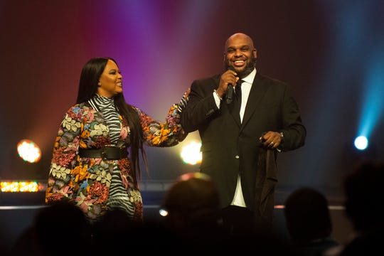 Pastors John and Aventer Gray talk to the crowd during the second service at Relentless Church on New Year's Eve Tuesday, Dec. 31, 2019.