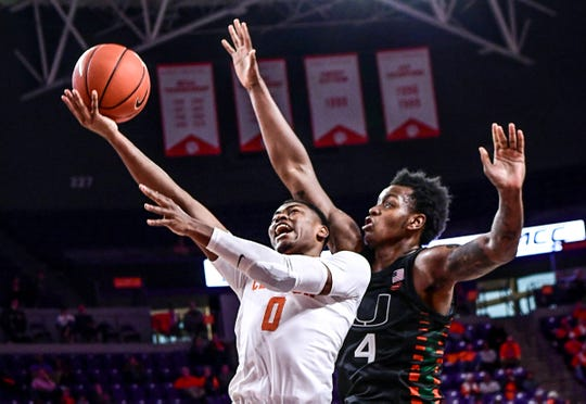 Clemson guard Clyde Trapp(0) shoots near Miami forward Keith Stone(4) during the second half at Littlejohn Coliseum Tuesday, December 31, 2019.