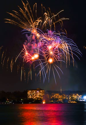 Bursts of color light up the midnight skies over Tumon Bay during a fireworks display held to celebrate the New Year in this Jan. 1 file photo. Numerous cancellations this year due to the COVID-19 pandemic, reflect a general trend across fireworks businesses worldwide.