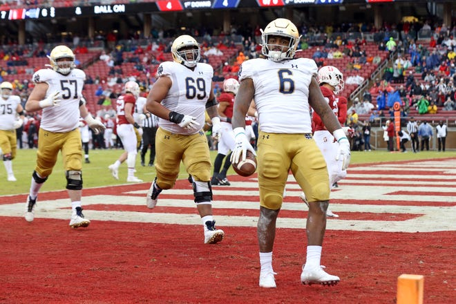 Nov 30, 2019; Stanford, CA, USA; Notre Dame Fighting Irish running back Tony Jones Jr. (6) celebrates after scoring a touchdown during the first quarter against the Stanford Cardinal at Stanford Stadium.