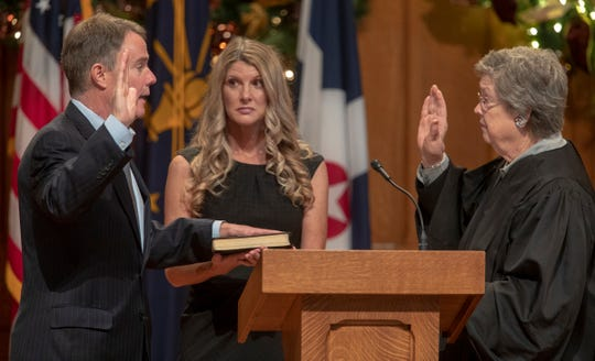 Joe Hogsett (left), is sworn in for his second term as mayor by Judge Sarah Evans Barker, as his wife, Steph Hogsett, holds the Bible, Indianapolis, Wednesday, Jan. 1, 2020.