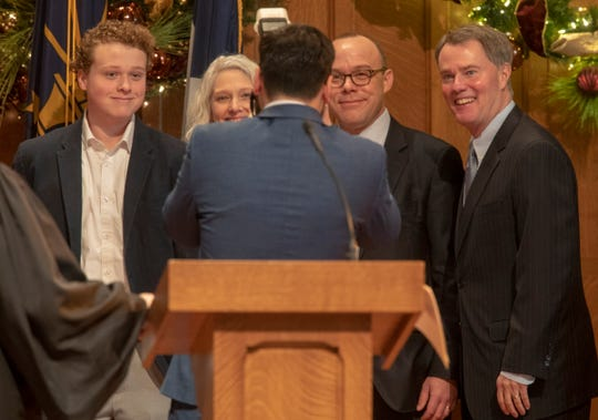 John Barth (second from right), his family and Mayor Joe Hogsett (far right), are photographed at a swearing-in ceremony for Hogsett and incoming City-County Council members on January 1.