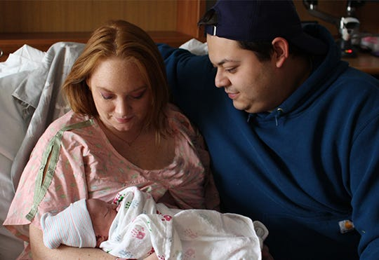 Kayla Pitchford and Josh Smith hold their son, Reid Christopher Smith, at McLaren Greater Lansing Jan. 1, 2020. Reid was the first baby to be born in 2020 at McLaren.