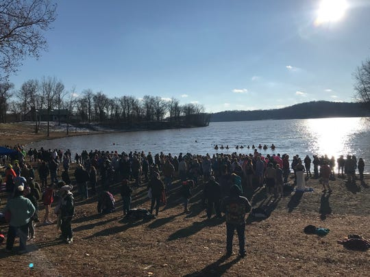 A large crowd turned out on New Year's Day for the 14th annual Polar Bear Dip at Charles Mill Lake. The event raises money for cancer awareness.