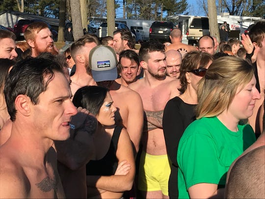 People waited anxiously for the Polar Bear Dip on New Year's Day at Charles Mill Lake to begin.
