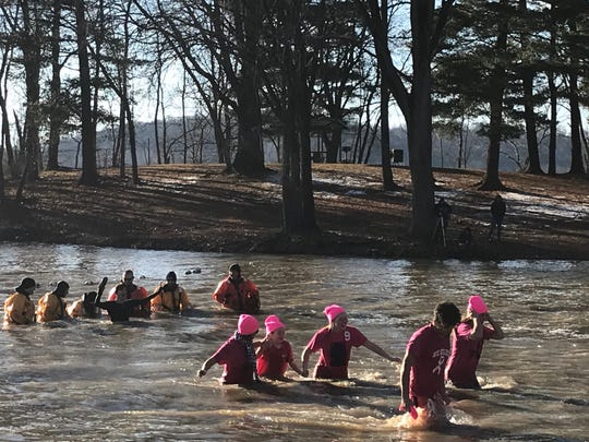 A group of friends from Jeromesville and Hillsdale High School including Olivia Betson joined together at the Polar Bear Dip on New Year's Day.