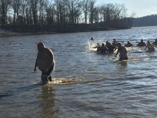 Hundreds of people jumped into Charles Mill Lake on New Year's Day for the annual Polar Bear Dip.