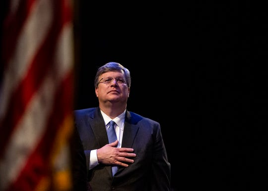Memphis Mayor Jim Strickland stands during the national  anthem at the City of Memphis swearing-in ceremony on January 1, 2020 at the Michael D. Rose Theatre Lecture Hall.