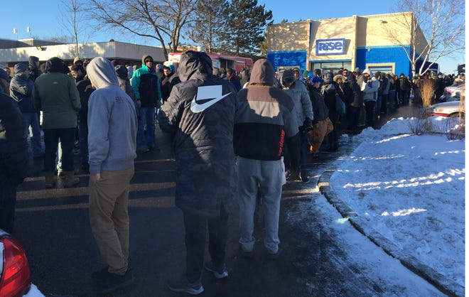 Throngs of people wait to purchase marijuana and products containing THC on Wednesday at Rise Dispensaries in Mundelein, Illinois. Jan. 1 was the first day for recreational marijuana to be sold legally in the state.
