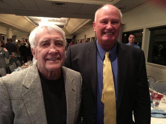 Bob Larsen (left) poses with former Arrowhead football coach Tom Taraska at the school's athletic hall of fame induction ceremony in 2016.  Larsen was the first assistant coach inducted.