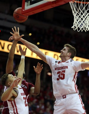 Badgers forward Nate Reuvers (35) blocks the shot a Rider player Tuesday night.