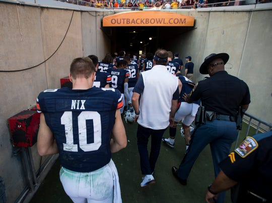 Auburn quarterback Bo Nix (10) and Auburn head coach Gus Malzahn walk off the field during the Outback Bowl at Raymond James Stadium in Tampa, Fla., on Wednesday, Jan. 1, 2020. Minnesota defeated Auburn 31-24.
