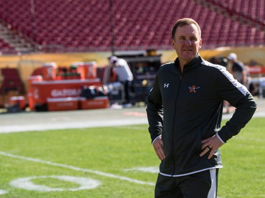 Auburn offensive coordinator Chad Morris walks the field before the Outback Bowl at Raymond James Stadium in Tampa, Fla., on Wednesday, Jan. 1, 2020.
