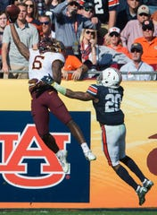 Minnesota  wide receiver Tyler Johnson (6) catches a touchdown pass over Auburn defensive back Jeremiah Dinson (20) during the Outback Bowl at Raymond James Stadium in Tampa, Fla., on Wednesday, Jan. 1, 2020. Minnesota leads Auburn 24-17 at halftime.