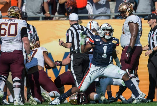 Auburn defensive lineman Big Kat Bryant (1) celebrates after stopping Minnesota wide receiver Seth Green (17) on third down during the Outback Bowl at Raymond James Stadium in Tampa, Fla., on Wednesday, Jan. 1, 2020.