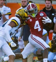 Alabama wide receiver Jerry Jeudy (4) carries late against Michigan in the Citrus Bowl in Orlando, Fla., on Wednesday January 1, 2020.