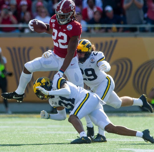 Alabama running back Najee Harris (22) hurdles Michigan defensive back Vincent Gray (31) in the Citrus Bowl in Orlando, Fla., on Wednesday January 1, 2020.