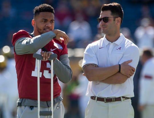 Alabama injured quarterback Tua Tagovailoa  chats with Vinnie Sunseri before the Citrus Bowl in Orlando, Fla., on Wednesday January 1, 2020.