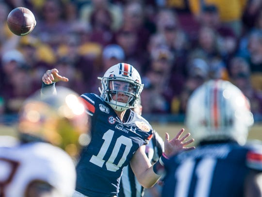 Auburn quarterback Bo Nix (10) throws the ball during the Outback Bowl at Raymond James Stadium in Tampa, Fla., on Wednesday, Jan. 1, 2020. Minnesota defeated Auburn 31-24.