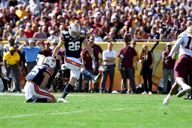 Auburn placekicker Anders Carlson (26) kicks a field goal during against Minnesota during the Outback Bowl at Raymond James Stadium on Jan. 1, 2020.