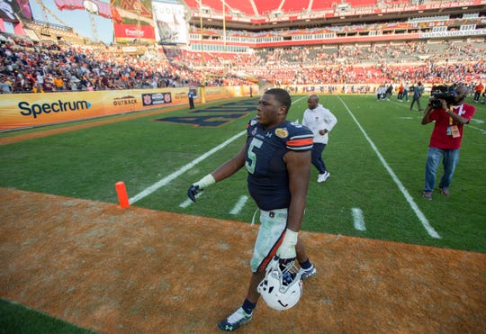 Auburn defensive lineman Derrick Brown (5) walks off the field after the game during the Outback Bowl at Raymond James Stadium in Tampa, Fla., on Wednesday, Jan. 1, 2020. Minnesota defeated Auburn 31-24.