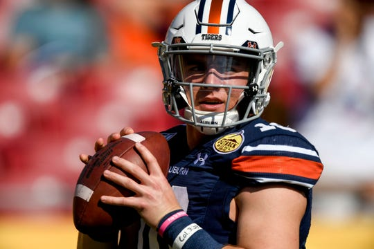 Auburn quarterback Bo Nix (10) warms up before the Outback Bowl against Minnesota at Raymond James Stadium on Jan. 1, 2020, in Tampa, FL.