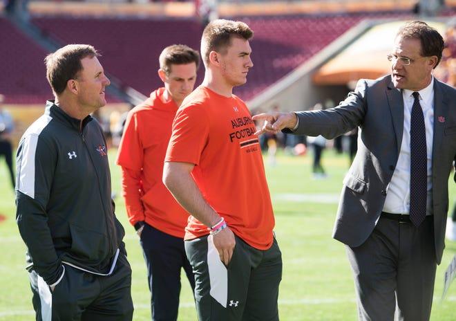 Auburn head coach Gus Malzahn walks the field with Auburn quarterback Bo Nix (10) and new offensive coordinator Chad Morris before the Outback Bowl at Raymond James Stadium in Tampa, Fla., on Wednesday, Jan. 1, 2020.