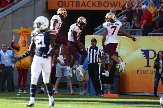 Jan 1, 2020; Tampa, Florida, USA; Minnesota Golden Gophers wide receiver Tyler Johnson (6) celebrates with teammates after scoring a touchdown against the Auburn Tigers during the second half at Raymond James Stadium. Mandatory Credit: Kim Klement-USA TODAY Sports