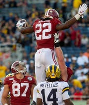 Alabama running back Najee Harris (22) is lifted after scoring his late touchdown against Michigan in the Citrus Bowl in Orlando, Fla., on Wednesday January 1, 2020.