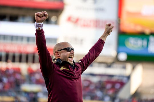 Jan 1, 2020; Tampa, Florida, USA; Minnesota Golden Gophers head coach PJ Fleck (sunglasses) reacts during the fourth quarter of the game against the Auburn Tigers at Raymond James Stadium. Mandatory Credit: Douglas DeFelice-USA TODAY Sports
