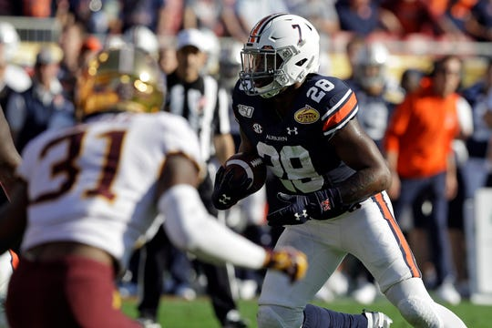 Auburn running back JaTarvious Whitlow (28) scores a 3-yard touchdown against Minnesota during the Outback Bowl on Wednesday, Jan. 1, 2020, in Tampa, Fla.