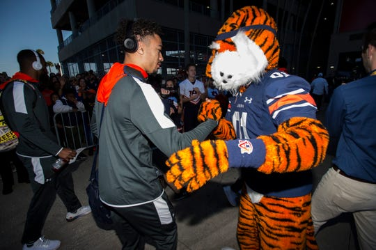 Auburn wide receiver Anthony Schwartz (5) is greeted by Aubie before the Outback Bowl at Raymond James Stadium in Tampa, Fla., on Wednesday, Jan. 1, 2020.