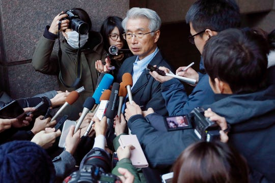 Junichiro Hironaka, center, lawyer for Nissan's former chairman Carlos Ghosn, speaks to the media in Tokyo, Tuesday, Dec. 31, 2019. Ghosn had been released on bail while awaiting trial but was not allowed to travel overseas. It's not clear how he left Japan, where he had been under surveillance.