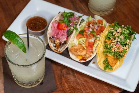 A trio of tacos from The Sutler.