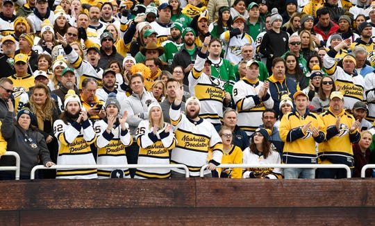 Nashville Predators fans cheer during the first period of the 2020 NHL Winter Classic against the Dallas Stars at the Cotton Bowl in Dallas, Texas, Wednesday, Jan. 1, 2020.