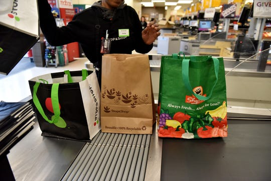 Starliga Darden, a cashier at Stop & Shop, helps a customer bag groceries and offers a free reusable bag at the Ridgewood store. On Jan. 1, 2020, the first day of the village's single-use plastic bag ban, the store provided reusable bags to its first 300 customers.