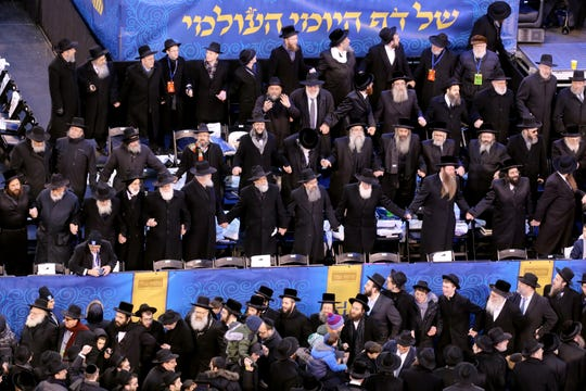 Jews dance while celebrating the Siyum HaShas in East Rutherford. Wednesday, January 1, 2020