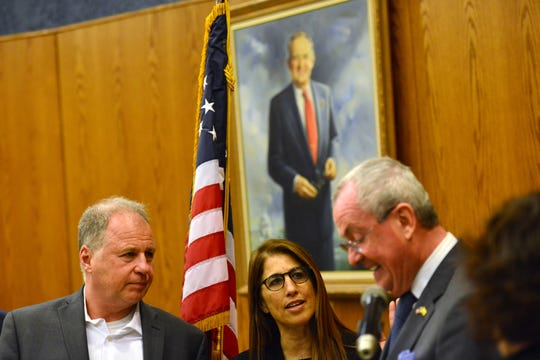 Francine Ritter, center, is sworn-in as the only Democrat on the Wayne Township Council, by N.J. Governor Phil Murphy, right, in Wayne, N.J. on Wednesday Jan. 1, 2020.