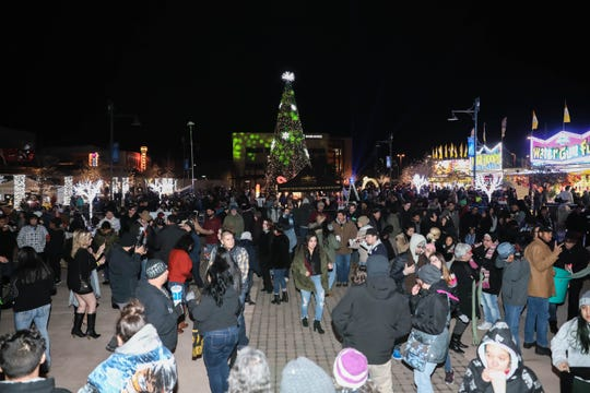 "Hundreds gather at the ""Chile drop"" in Downtown Las Cruces as part of the New Year's Eve celebration on Dec. 31, 2019."