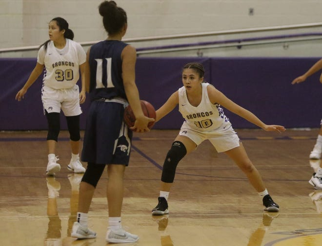 Kirtland Central's Monique Shim looks to get a defensive stop against Piedra Vista's Elaina Watson on Tuesday, Dec. 3, 2019, at Bronco Arena in Kirtland. PV, Kirtland and Navajo Prep are all ranked No. 1 in this week's girls basketball polls.