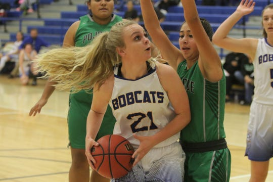 Bloomfield's Halle Payne attacks the basket against Pojoaque Valley on Saturday, Dec. 7, 2019, at Bobcat Gym in Bloomfield.