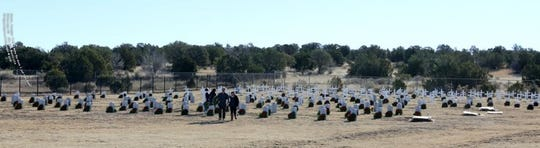 An overview of the old military cemetery at Fort Stanton shows wreaths at the graves.