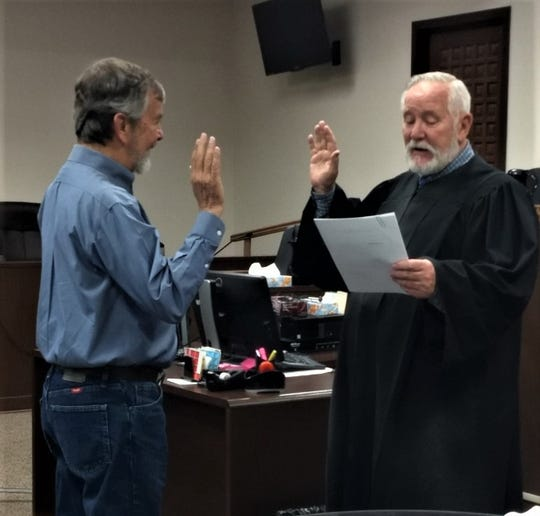 Carrizozo Mayor Ray Dean is sworn into office by 12th Judicial Judge Daniel Bryant.