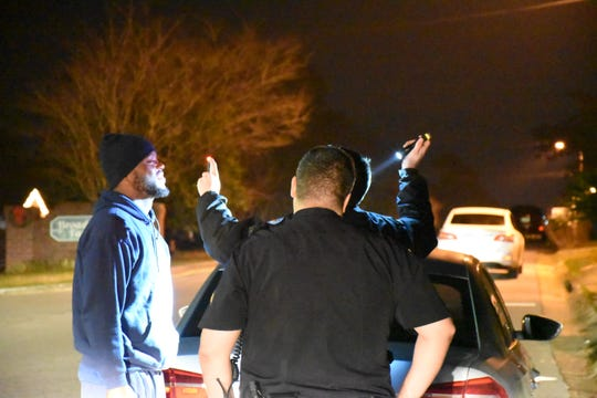 Pensacola Police Department officers conduct a field sobriety test shortly after midnight on Jan. 1.